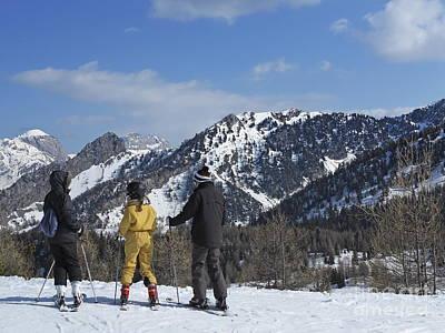 Family On Ski Contemplating Mountains Print by Sami Sarkis