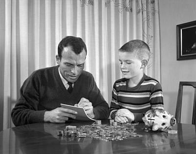 Father And Son Count Coins From Piggy Print by H. Armstrong Roberts/ClassicStock