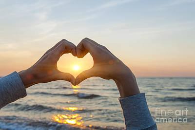 Fingers Heart Framing Ocean Sunset Print by Elena Elisseeva