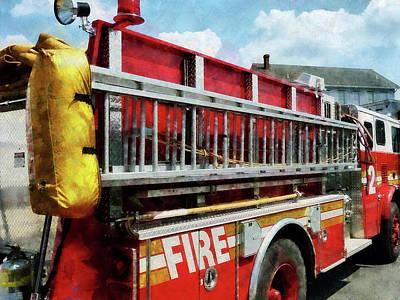 Ladder Photograph - Fireman - Long Ladder On Fire Truck by Susan Savad