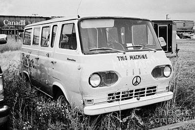 first generation ford econoline camper van with hippy symbols in a junkyard Saskatchewan Canada Print by Joe Fox
