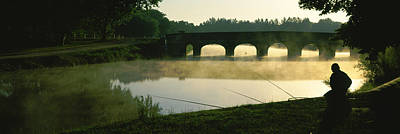 Stone Bridge Photograph - Fisherman Fishing In A River by Panoramic Images