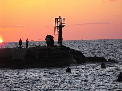 Fishermen At Sunset Print by Lionel Gaffen