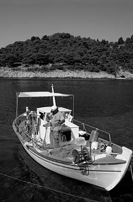 Fisherman Painting - Fishing Boat In Asos Village by George Atsametakis