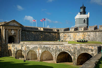 Flags Flying Over Fortress El Morro Print by Brian Jannsen