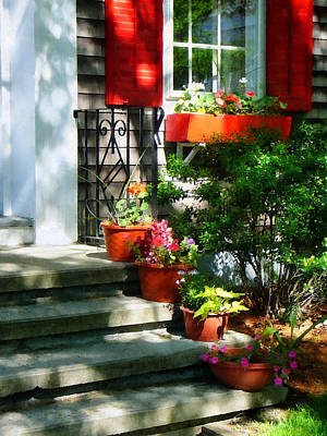 Geranium Photograph - Flower Pots And Red Shutters by Susan Savad