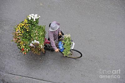 Flower Seller In Street Of Hanoi Print by Sami Sarkis
