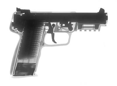 Fn Photograph - Fn 57 Hand Gun X-ray Photograph by Ray Gunz