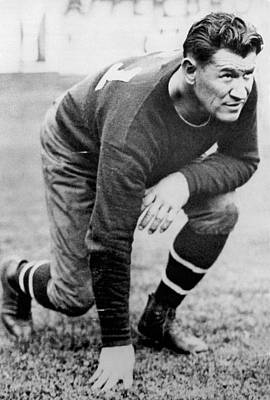 Crouched Photograph - Football Player Jim Thorpe by Underwood Archives