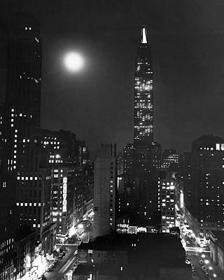 Nightlights Photograph - Full Moon Over Manhattan by Underwood Archives