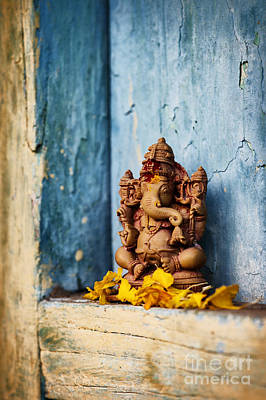 Ganesha Statue And Flower Petals Print by Tim Gainey