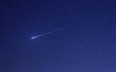 Geminid Meteor Print by Luis Argerich