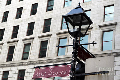 Que Photograph - General View Of A Street Sign For Rue Saint-jacques With Lamp Post by Jason O Watson