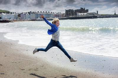 Candid Photograph - Girl Leaping On Beach by Samuel Ashfield