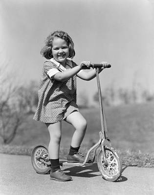 Girl On Scooter, C.1930s Print by H. Armstrong Roberts/ClassicStock