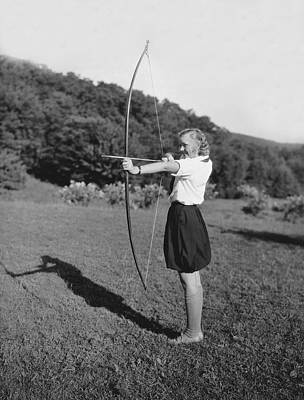Girl Scout With Bow And Arrow Print by Underwood Archives