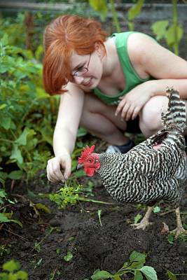 The Friendly Flower Photograph - Girl With Free Range Chicken by Jim West