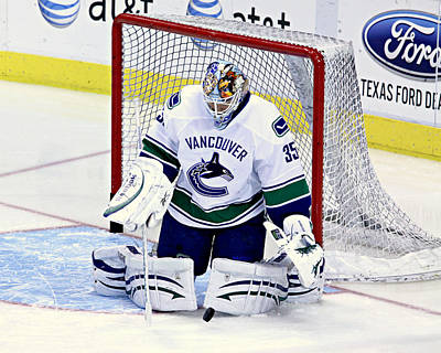 Vancouver Canucks Photograph - Goalie Save 2 by Stephen Stookey