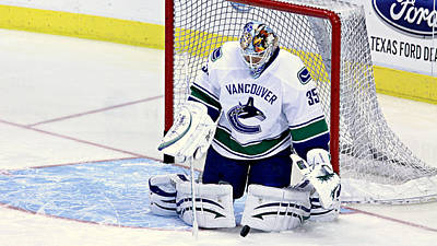 Vancouver Canucks Photograph - Goalie Save by Stephen Stookey
