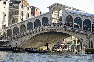Photograph - Gondolas Beneath Rialto Bridge On Grand Canal by Sami Sarkis