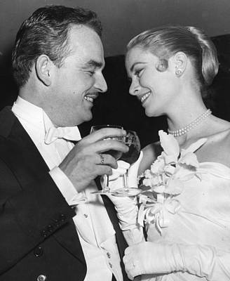 Grace Kelly Toasts With Husband Print by Retro Images Archive