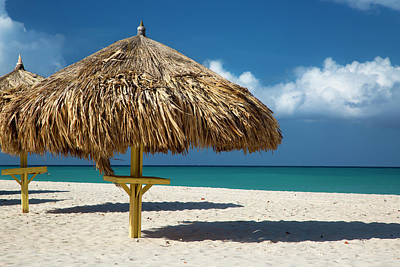 Aruba Photograph - Grass Umbrellas Along The White Sandy by Brian Jannsen
