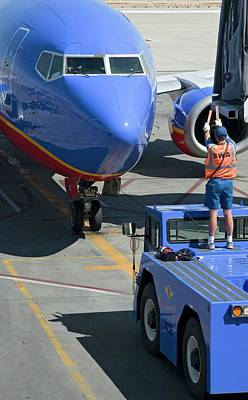 Airliners Photograph - Ground Crew Directing Jet Airliner by Jim West