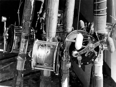 Group Of Fishing Poles Print by Retro Images Archive