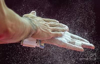 Gymnast Photograph - Gymnast Applying Rosin To Hands by Ria Novosti