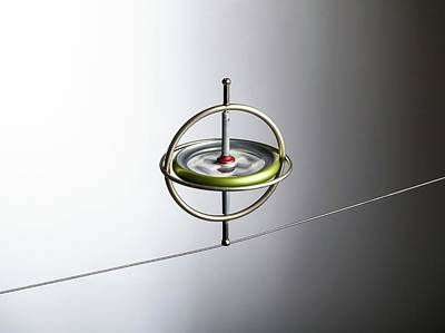 Angular Photograph - Gyroscope Balancing On A Wire by Science Photo Library