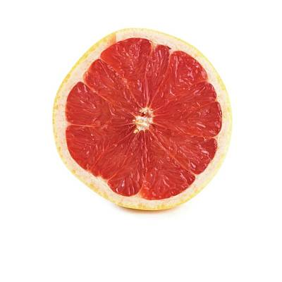 Grapefruit Photograph - Half A Grapefruit by Science Photo Library