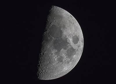 Half Of The Moon Illuminated In A Dark Print by John Short