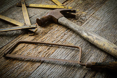 Hammer Saw And Measuring Tape On Rustic Wood Background Print by Brandon Bourdages