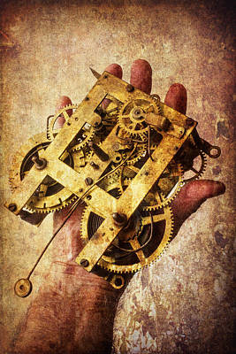 Hand Holding Clock Gears Print by Garry Gay
