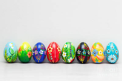 Wall Photograph - Hand-painted Easter Eggs On White Rustic Wall by Michal Bednarek