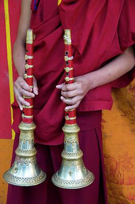 Hands Of Young Monk Holding Ceremonial Print by Ellen Clark