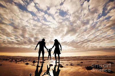 Child Photograph - Happy Family Together Hand In Hand On The Beach At Sunset by Michal Bednarek