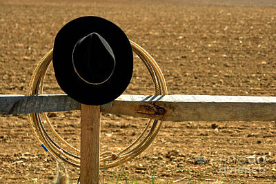 Hat And Lasso On Fence Print by Olivier Le Queinec