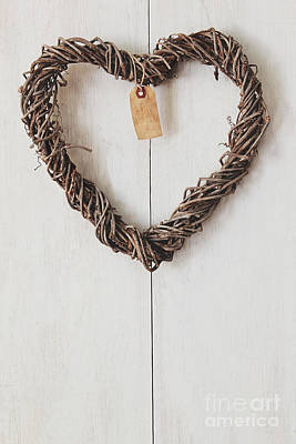 Heart Wreath Hanging On Wood Background Print by Sandra Cunningham