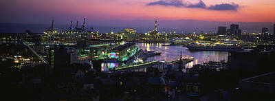 Genoa Photograph - High Angle View Of City At A Port Lit by Panoramic Images
