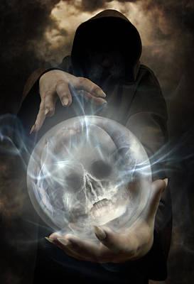 Hooded Man Wearing Dark Cloak Holding Glowing Crystall Ball With Human Skull Image Inside Print by Jaroslaw Blaminsky