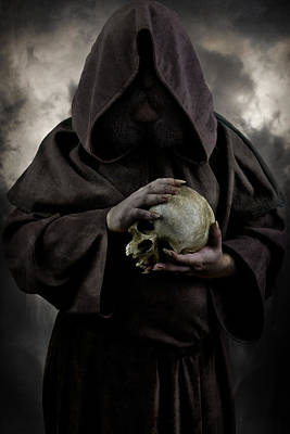 Hooded Moustached Man Wearing Dark Cloak And Holding A Human Skull In His Hands Print by Jaroslaw Blaminsky