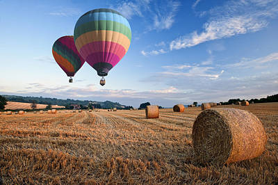 Hot Air Balloons Over Hay Bales Sunset Landscape Print by Matthew Gibson