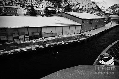 Hurtigruten Crew Member Throws Ships Rope Guide Line To Dock Worker Oksfjord During Winter Norway Eu Print by Joe Fox
