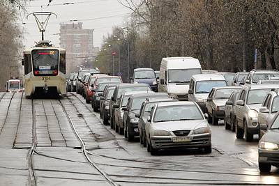 Illegally Parked Cars Next To Tramline Print by Science Photo Library