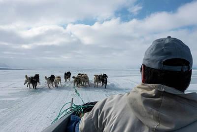 Husky Photograph - Inuit Hunter And Husky Dog Team by Louise Murray