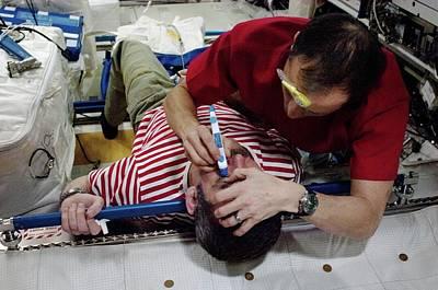 Exam Photograph - Iss Astronaut Eye Exam by Nasa