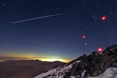 Iss Crossing The Night Sky Print by Babak Tafreshi