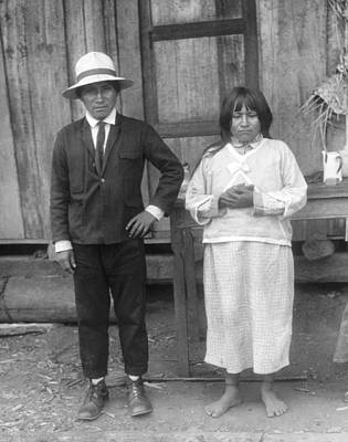 Husband Waiting Photograph - Jivaro Headhunter And His Wife by Underwood Archives