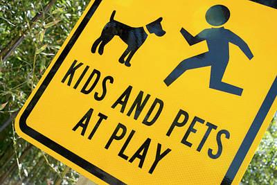 Kids And Pets At Play, Warning Sign Print by Julien Mcroberts